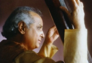 head and shoulder of pandit jasraj, holding tanpura, taken from the right side