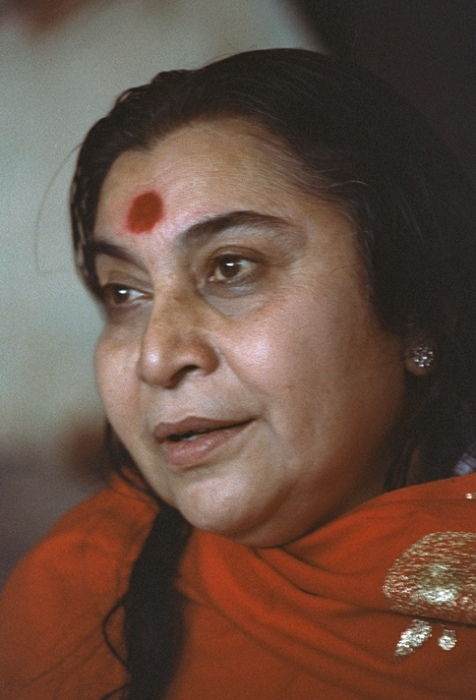 Shri Mataji with a red shawl, three quarter profile from the left